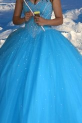 A winter bride in beautiful blue gown with Alaskan mountain background