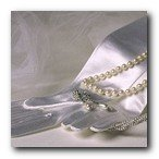 elegant wedding gloves and pearls