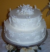 two tiered wedding cake topped with white chocolate snowflakes